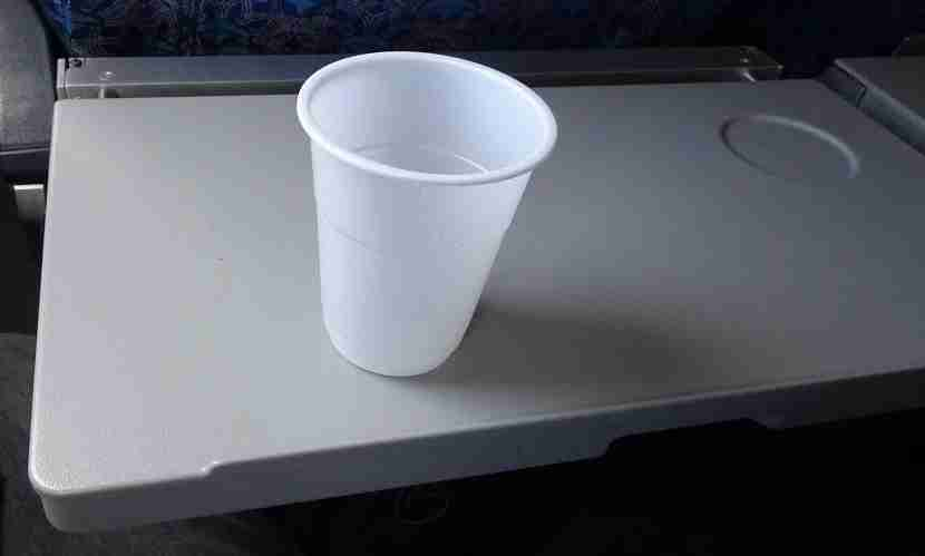 Warm 7UP on a sturdy tray table.