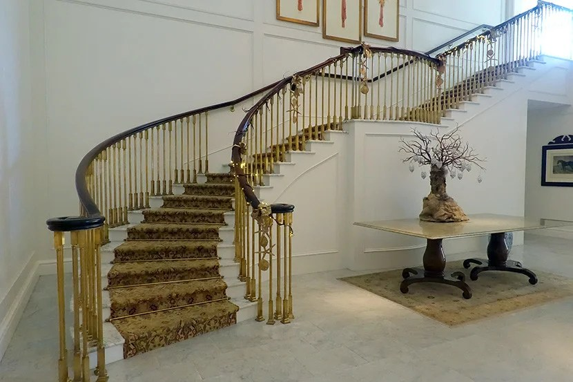 The gorgeous staircase leading up to the rooms — there's also an elevator.