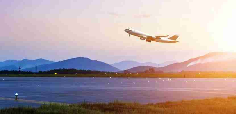 Plane taking off featured shutterstock 157459556