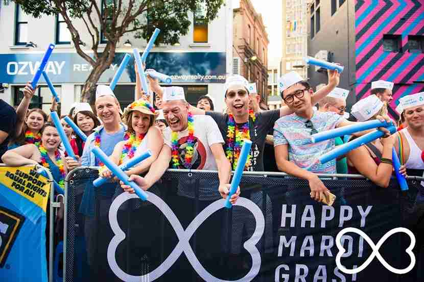 Revelers line the streets for the parade during Sydney Mardi Gras. Image courtesy of Sydney Gay & Lesbian Mardi Gras.