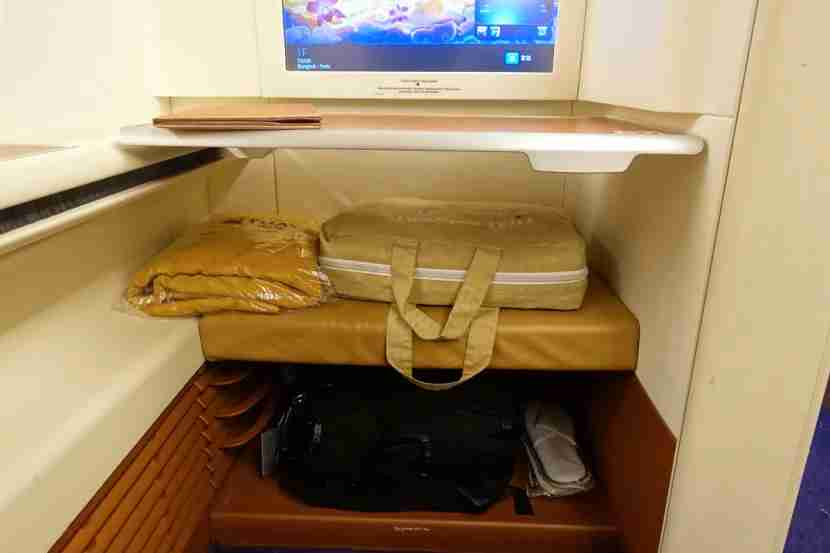You can store a small bag below the ottoman.
