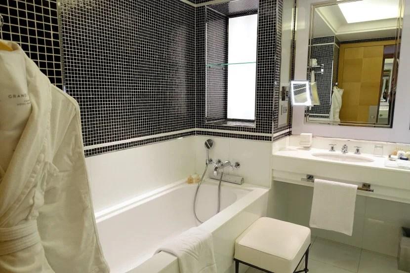 The bathroom includes a standalone tub.