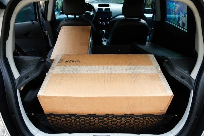 This 26in x 14in x 14in box of camera lenses fit nicely in the back, popping the back seats down for even more room.