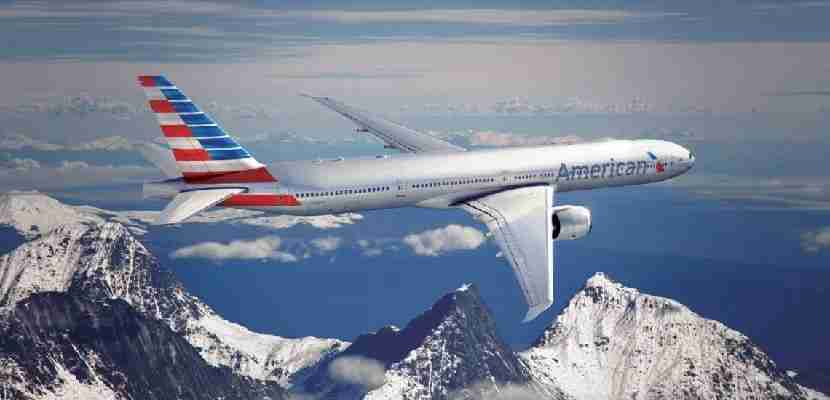 American Airlines plane over mountains.