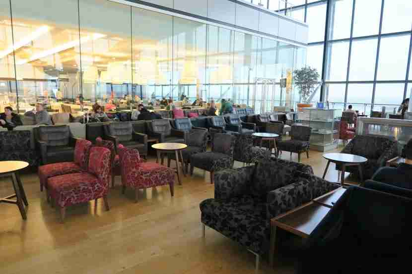 One of the sitting areas in the lounge, with the large glass windows looking out over the runway.