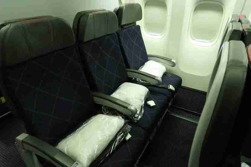 Row 18 is the third and final row in a small Main Cabin Extra cabin.