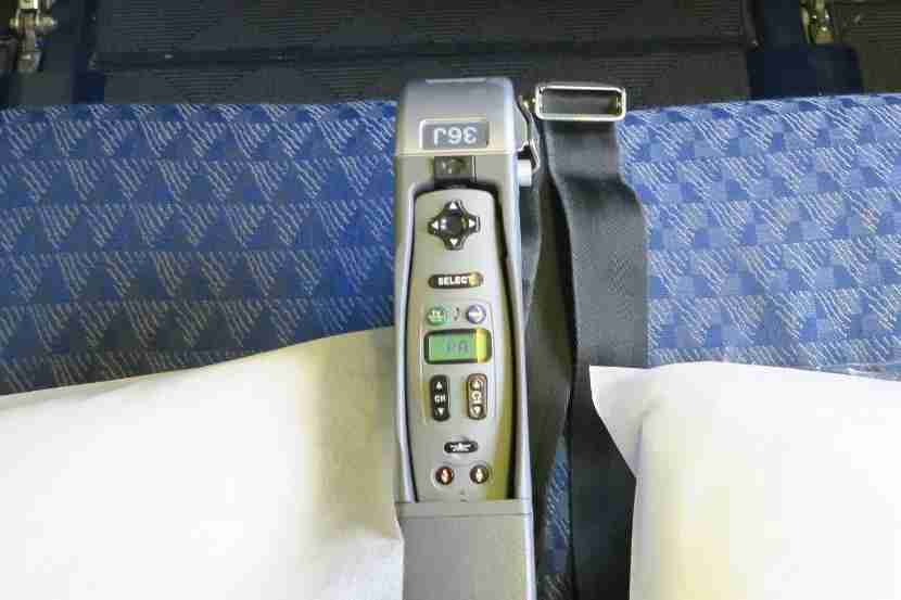 Storing the in-flight entertainment handset in the arm rest is really poor design.