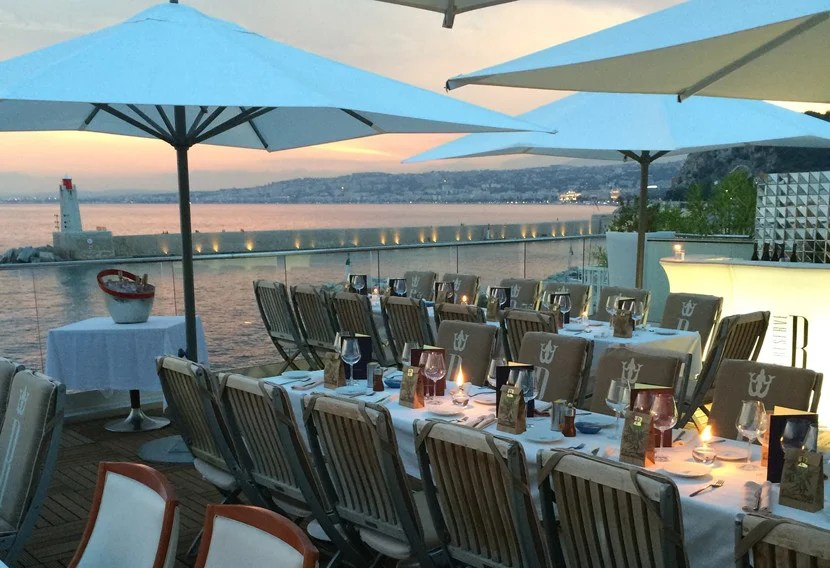 Catch the sunset from a seaside restaurant like La Réserve in Nice. Image courtesy of La Réserve's Facebook page.