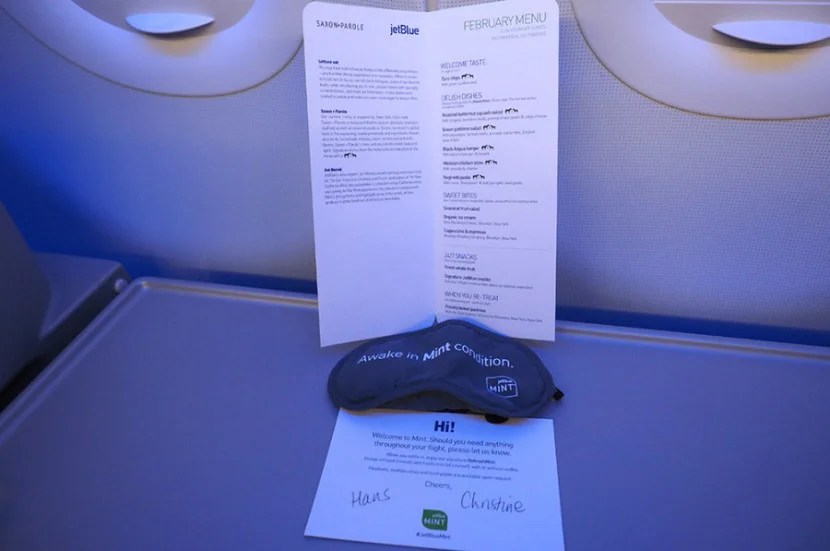 The nice food menu and a note from the great flight attendants.