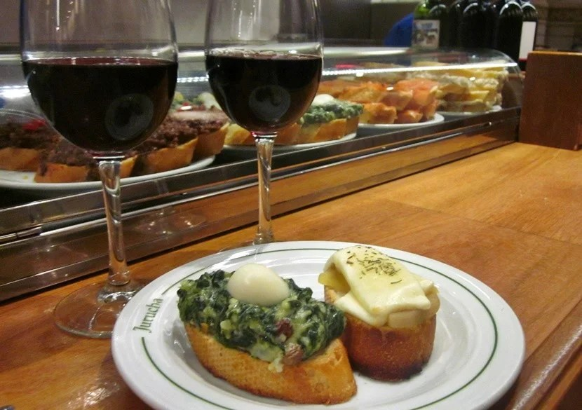 Creamed spinach with egg and goat cheese with pineapple tostas at Jurucha Tapas Bar.