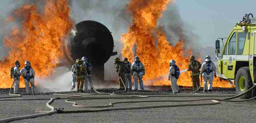 Here, firefighters practice what to do in case of an aircraft fire. Image courtesy of Shutterstock.