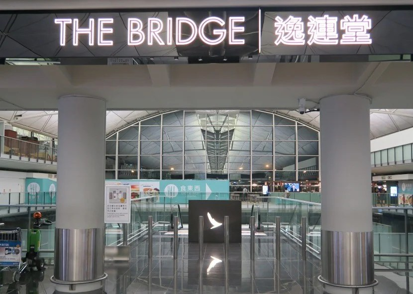 """Rather ironically, you have to head down escalators from the terminal floor to reach """"The Bridge"""" lounge."""