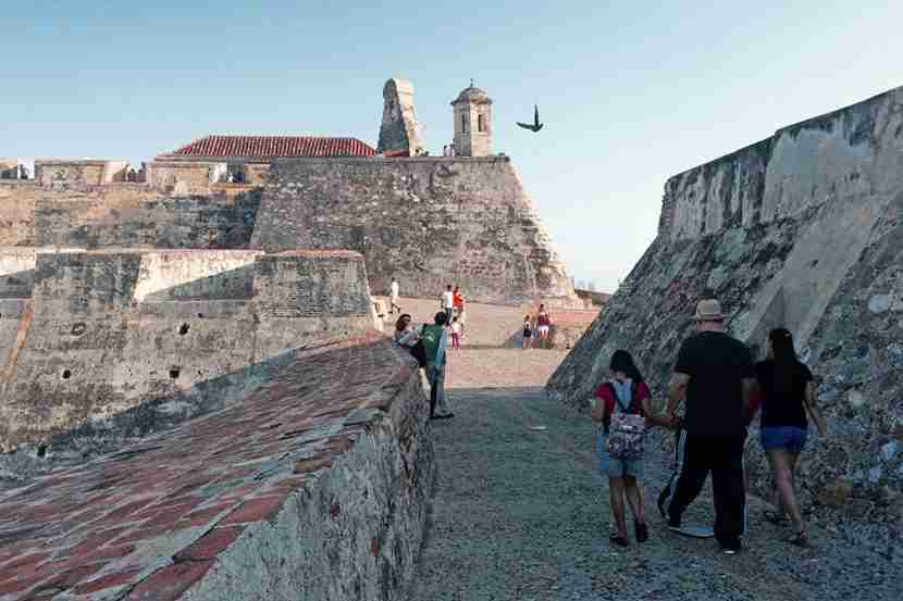 A modern-day family strolling the walls of Spanish-Colonial Cartagena