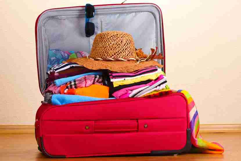 Using packing cubes (especially compression ones) is a good idea for fixing an overflowing suitcase. Photo courtesy of Shutterstock.