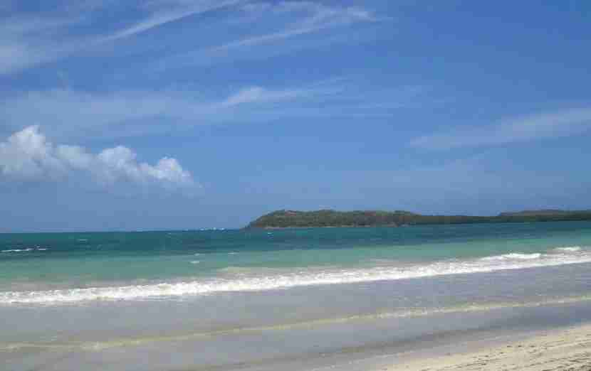 The white sands and turquoise waters of Playa Medio Mundo.