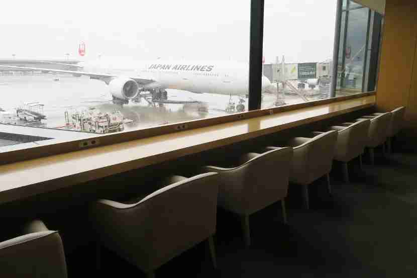 The Sakura lounge features many work and seating areas with views of the tarmac.