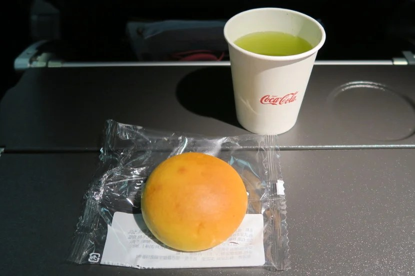 The mid-flight snack consisted of a choice of juice or tea and a meat bun.