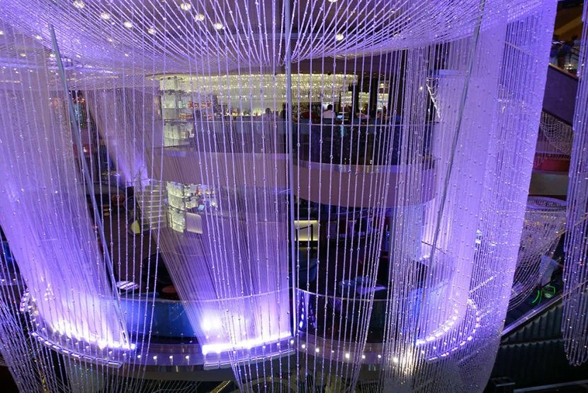 Awesome The multi story Chandelier bar and lounge area