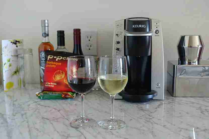 Our welcome wines in front of the minuscule selection of free snacks.