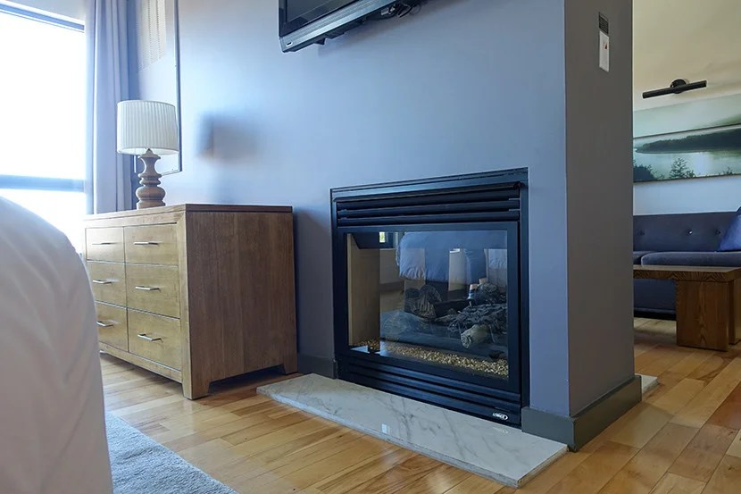Who doesn't love a modern fireplace, especially when it doubles as a room divider?