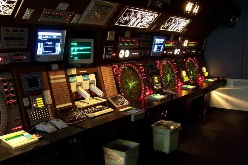 "This is where many controllers spend their work day. Image courtesy of <a href=""http://sportysnetwork.com/airfacts/wp-content/blogs.dir/13/files/2011/10/ATC.jpg"" target=""_blank"">Sporty's</a>."