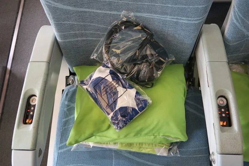 Economy Comfort seats contained a packaged blanket, pillow, amenity kit and noise canceling headphones.