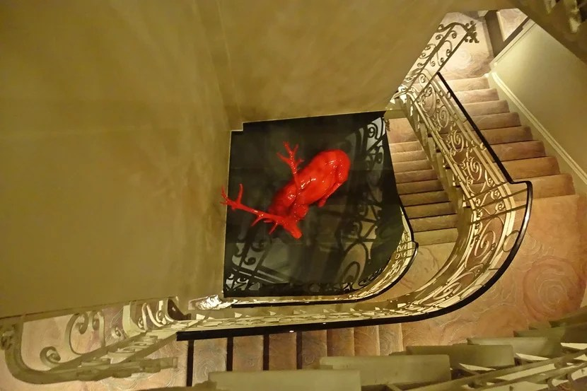 Surprise! Another red reindeer waiting to greet you on the stairs.