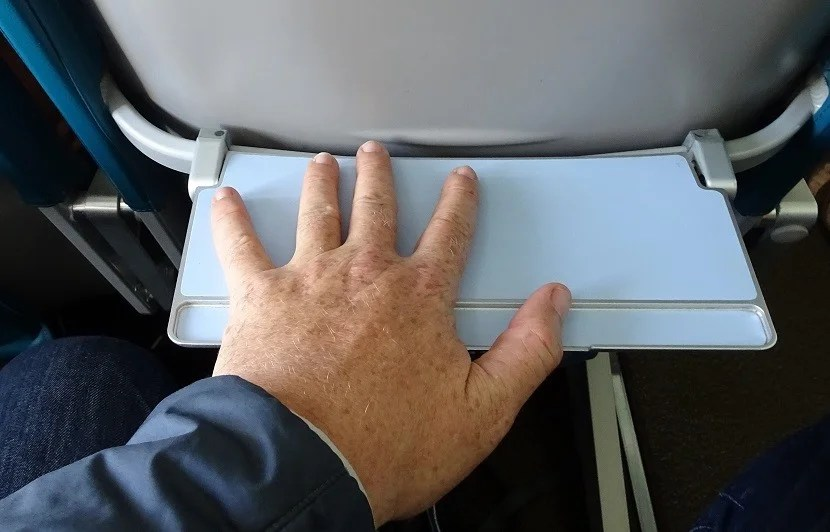 Look like you have giant hands when you use the tiny tray table.