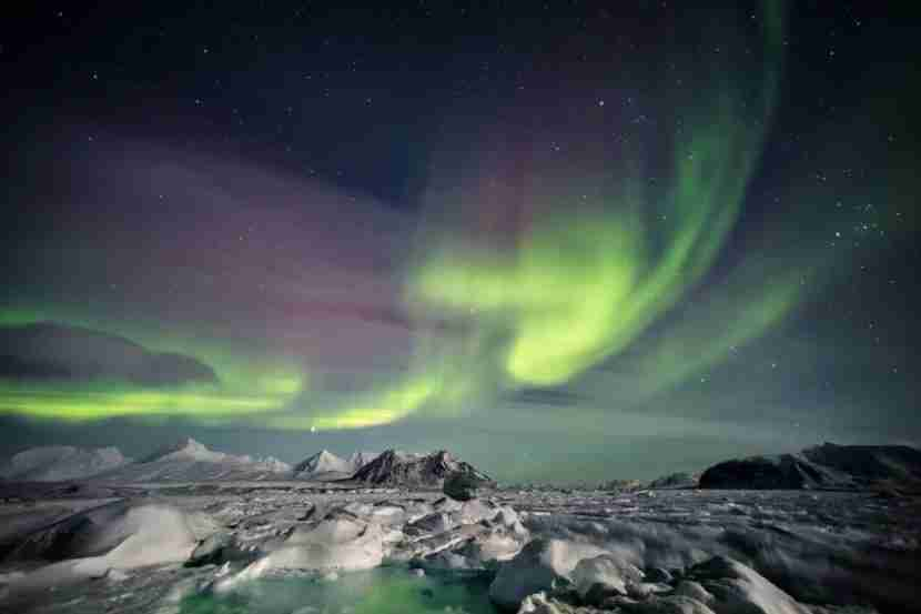 """Svalbard is the starting point for North Pole adventures and a great place to see the Northern Lights. Image courtesy of <a href=""""http://www.shutterstock.com/pic-240621760/stock-photo-beautiful-aurora-borealis-spitsbergen-svalbard.html?src=FTJirNoG4_JWPF5FeQivfA-1-0"""" target=""""_blank"""">Shutterstock</a>."""