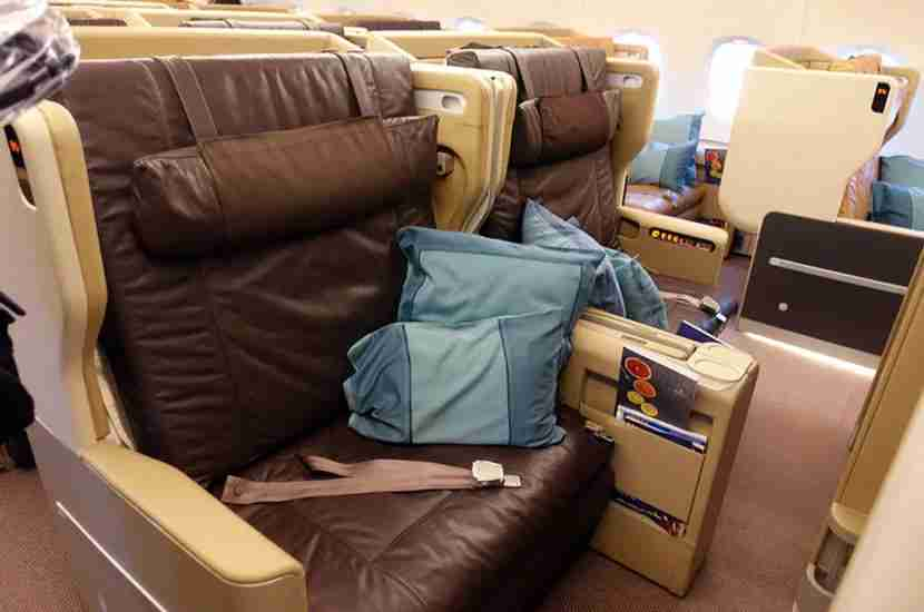 The business-class cabin is arranged in a 1-2-1 formation, and each seat folds to a lie-flat bed.