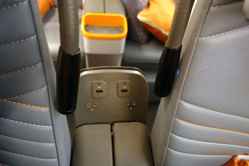 The headphone jack and another USB port at the back of the armrest.