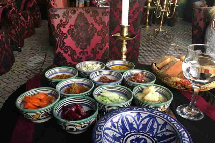 Tasting traditional Moroccan salad in Marrakesh.