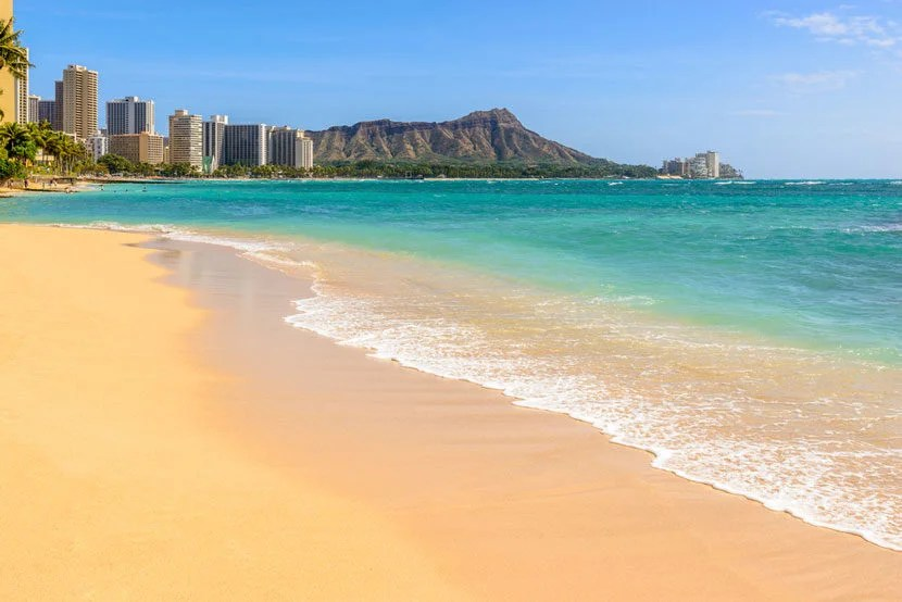 "Honolulu's Waikiki beach is famous for luxury hotels and popular with beachgoers. Image courtesy of <a href=""http://www.shutterstock.com/pic-358901948/stock-photo-waikiki-beach-in-honolulu-hawaii.html?src=undefined-1-0"" target=""_blank"">Shutterstock</a>."