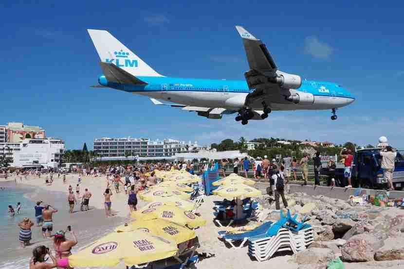 "A KLM 747 on Final Approach into SXM Airport. Image courtesy of <a href=""http://www.shutterstock.com/pic-235003774/stock-photo-saint-martin-dutch-antilles-november-the-beach-at-maho-bay-is-one-of-the-world-s.html?src=wBO4W7LHRoiW8646FAU-QQ-1-0"" target=""_blank"">Shutterstock</a>."