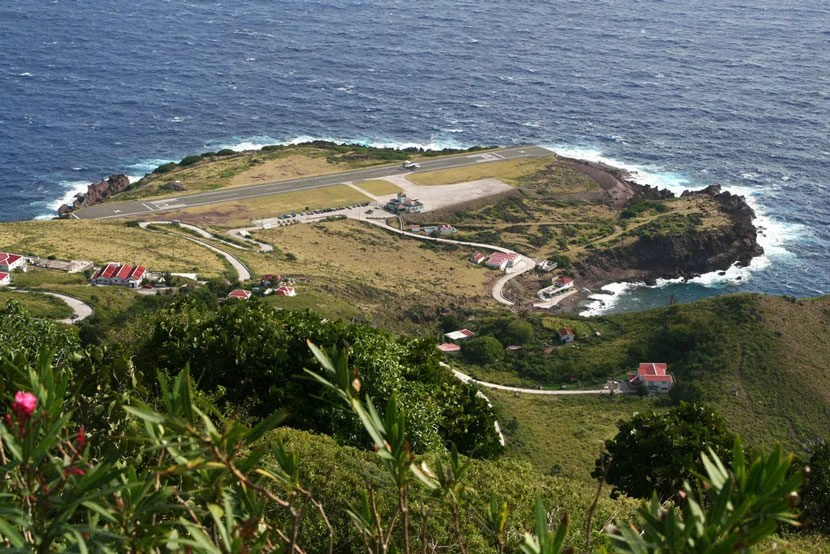 "Saba airport provides for a thrilling landing. Image courtesy of <a href=""http://www.shutterstock.com/pic-171422507/stock-photo-saba-island-with-airport.html?src=QejFgUvfHixAV4d-RYfqFA-1-0"" target=""_blank"">Shutterstock</a>."