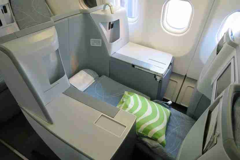 Each business class seat reclines into a lie-flat bed.
