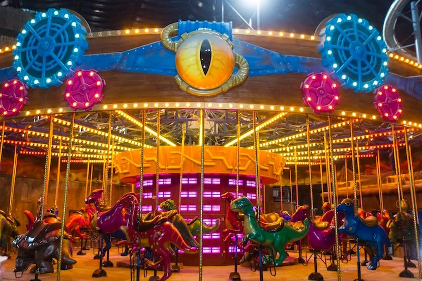 Carousels may not have existed during prehistoric times, but just go with it. Image courtesy of IMG Worlds of Adventure.