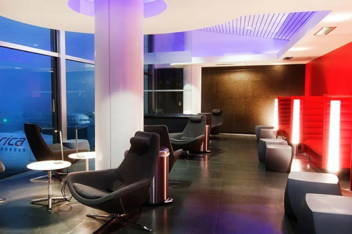 """The Virgin America Loft has large windows that make it a great spot to watch the planes on the tarmac below. Image courtesy of <a href=""""https://www.virginamerica.com/cms/fly-with-us/vx-lounges/lax"""">Virgin America</a>."""