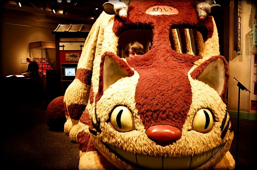 """Even if you're too old to climb inside, don't miss the real-life Cat Bus at the Ghibli museum. Image courtesy of <a href=""""https://upload.wikimedia.org/wikipedia/commons/b/b6/Cat_Bus_in_real_life.jpg"""">Wikipedia</a>."""