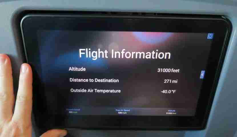 In-flight entertainment screen with my hand as a comparison.