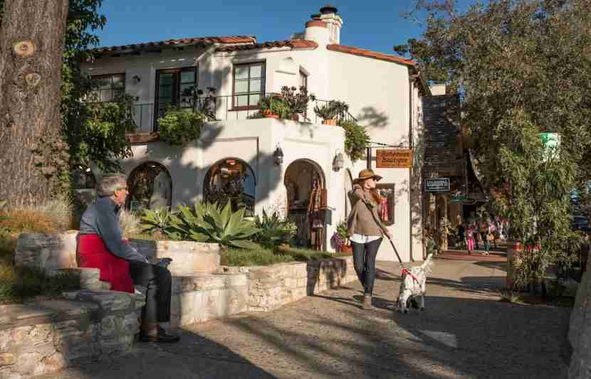 """City-dwellers love to escape to the picturesque town of Carmel. Image courtesy of <a href=""""http://www.shutterstock.com/pic-344715023/stock-photo-carmel-by-the-sea-california-united-states-november-28-2015-a-fashionably-dressed-tall-and-slender-woman-strolls-down-a-sidewalk-in-carmel-on-a-november-afternoon.html?src=ulZXq4TrSkZiZufelE3Gnw-1-1"""">Shutterstock</a>."""
