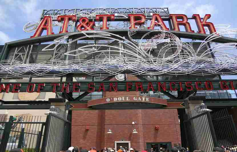 """Visit AT&amp;T Park and eat healthy in its in-stadiumgardens. Image courtesy of <a href=""""http://www.shutterstock.com/pic-290367431/stock-photo-san-francisco-june-7-at-and-t-park-home-of-the-giants-neon-sign-during-day-as-people-enter-park-for-ballgame-june-7-2011-att-park-san-francisco-california.html?src=3xuHV9wURwDqYsMaTwyHiQ-1-12"""">Shutterstock</a>."""