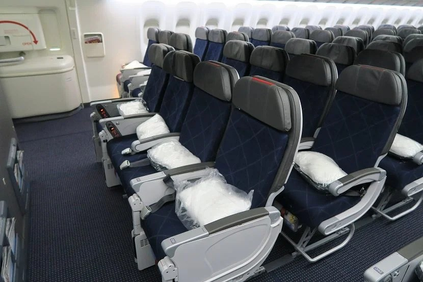 Row 26 is the bulkhead of the rear economy cabin.