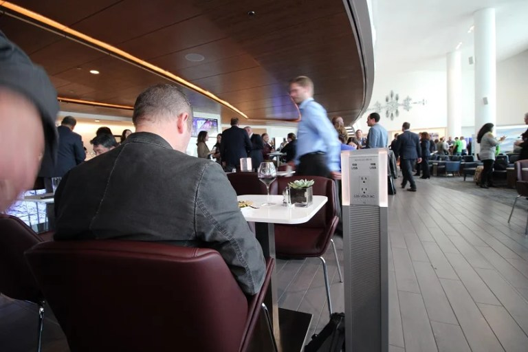 img-delta-sky-club-seattle-bar-low-table