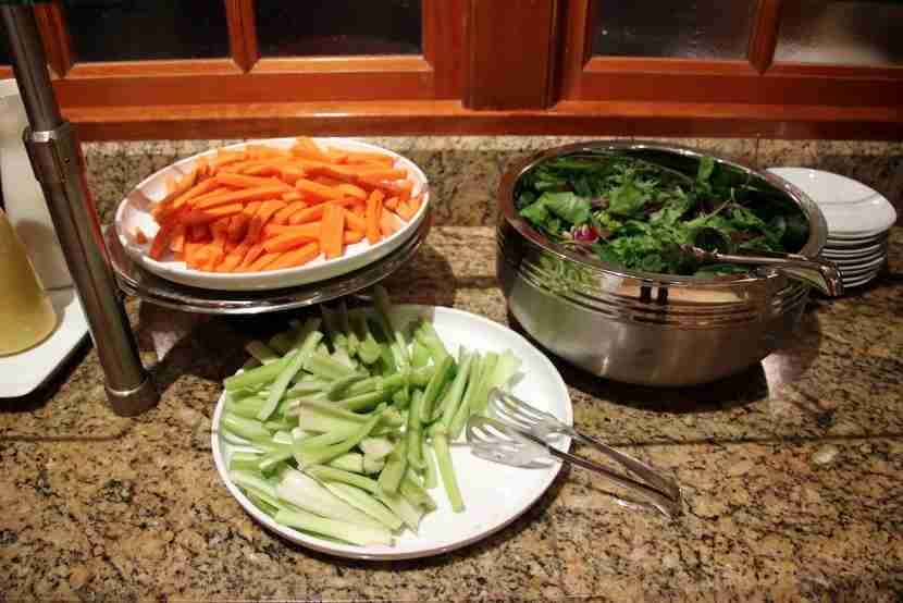 Carrots, celery and mixed greens for salad