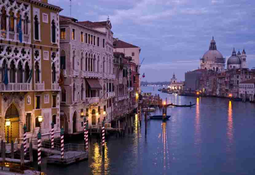 Cruise the canals in Venice, Italy. Image by Petegar/Getty.