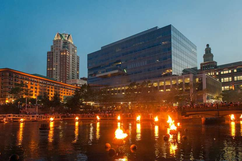 The rivers of Providence glow with WaterFire. Image courtesy of Yiming Chen via Getty Images.