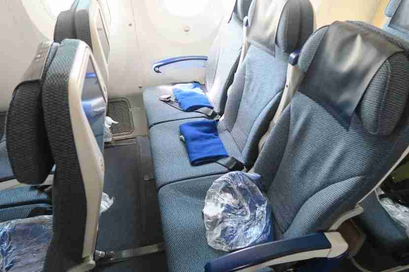 If you're lucky enough to have an empty flight, you might be able to lie flat in economy.