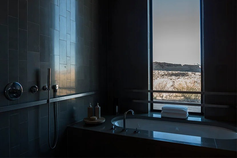 The view from the tub is impressive, but house rules forbid anyone from exploring the landscape outside, so you needn