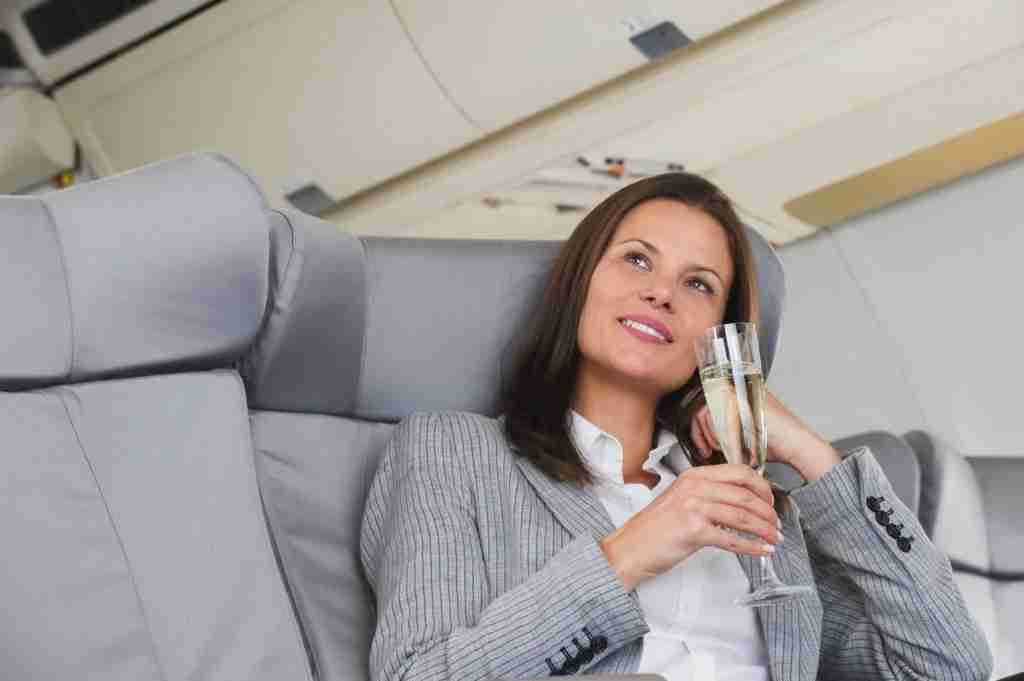 Unless the flight attendant is the one who gave her that champagne, this woman is probably committing a crime. Image courtesy of Westend61 via Getty Images.